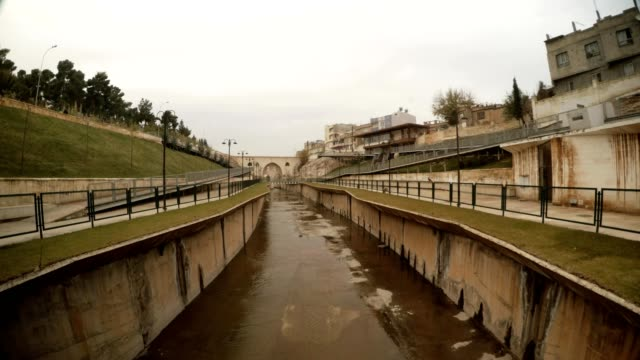 Panorama Ancient Canal Bird Fly Far Bridge Sanliurfa Cloudy Wintry Day video