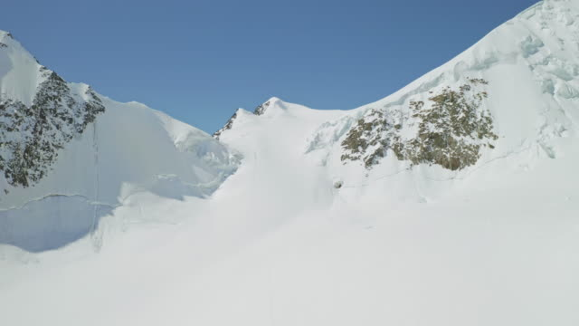 Panorama, dazzling snow white mountain, alpinists conquer over huge frozen slope