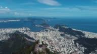 istock Panorama Landscape of Christ Redeemer Statue, Rio de Janeiro, Brazil. Vacation travel. Travel destination. Rio Tropical Touristic City. Rio de Janeiro, Brazil. Aerial Panoramic Sugarloaf Mountain 1267578260