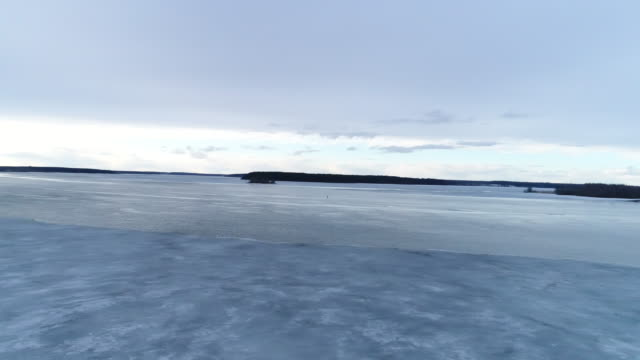 Panorama of a winter river with ice and water video