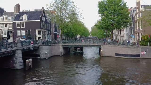 Panorama of Amsterdam street. Ordinary life in Amsterdam, the beautiful streets of Amsterdam, many bicycles in Amsterdam Panorama of Amsterdam street. Ordinary life in Amsterdam, the beautiful streets of Amsterdam, many bicycles in Amsterdam. dutch architecture stock videos & royalty-free footage
