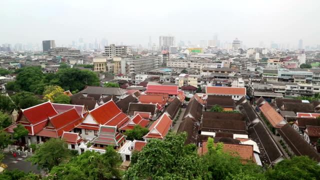 panorama of bangkok downtown. view from golden mountain, wat saket - верующий стоковые видео и кадры b-roll