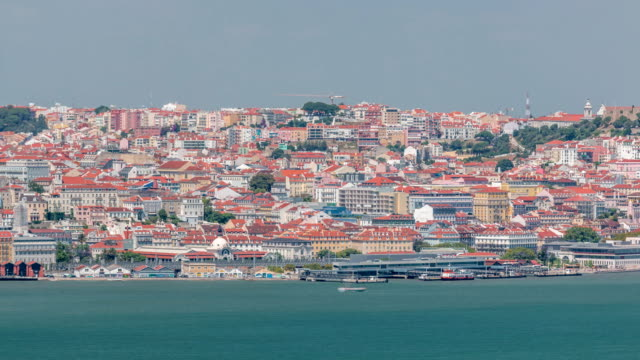 panorama of lisbon historical centre aerial timelapse viewed from above the southern margin of the tagus or tejo river - парагвай стоковые видео и кадры b-roll
