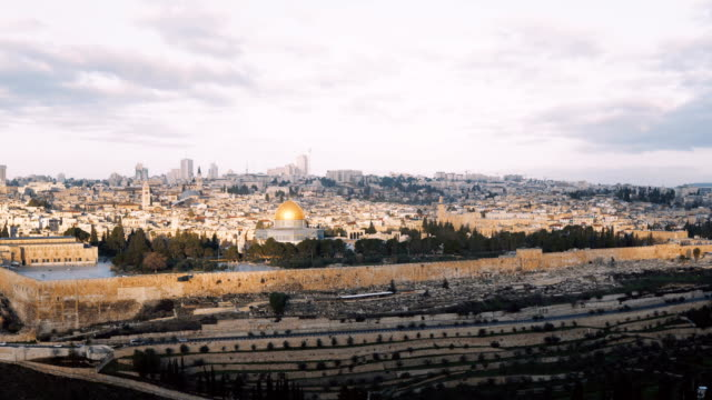 Panorama of old town Jerusalem, Israel. Panning left from Mount of Olives to ancient architecture religious buildings 4K video
