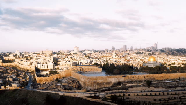 Panorama of old town Jerusalem, Israel. Panning right from Mount of Olives to Al-Aqsa, Temple Mount, Dome of the Rock 4K video