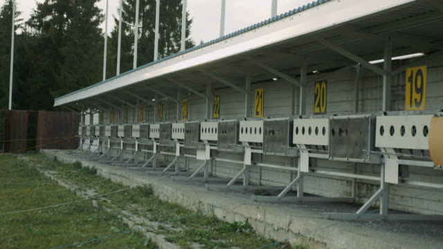 Panorama of targets for shooting at biathlon stadium. Numbering of shooting sports targets. Empty shooting range. Winter sports concept