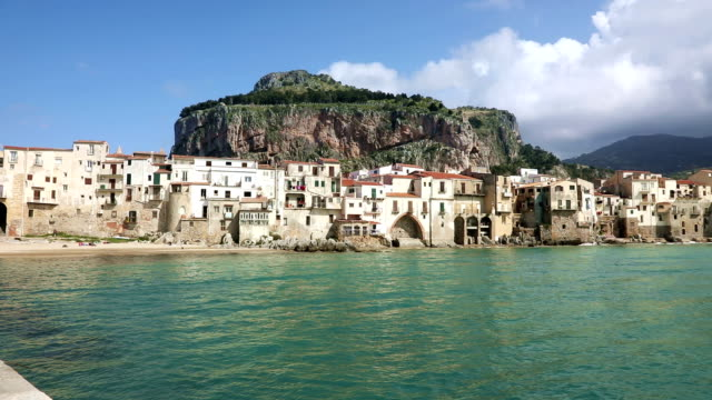 panorama of the coastline of cefalu town, italy - palermo città video stock e b–roll