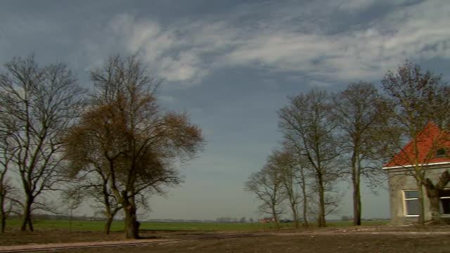 Panorama shot, trees to old farmhouse