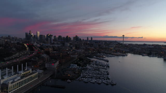 Panoramic Aerial City View Seattle Sunset Pink Orange Vibrant Sky Establishing Shot Above Lake Union