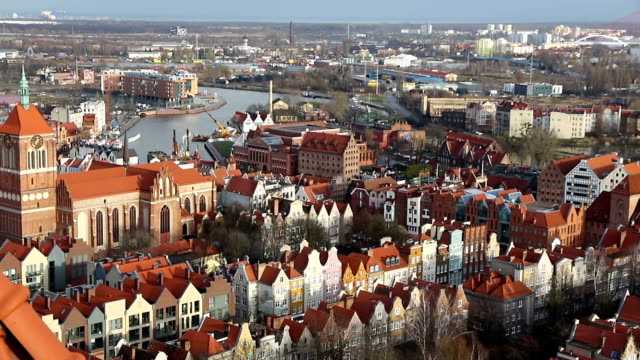Panoramic aerial view of Gdansk old town, Poland Panoramic aerial view of Gdansk old town, Poland. View from St. Mary's Church (Basilica of the Assumption of the Blessed Virgin Mary). Foggy winter morning gdansk stock videos & royalty-free footage