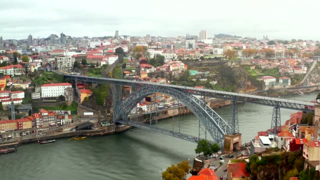 Panoramic aerial view of old houses of Porto Panoramic aerial view of old houses of Porto, Portugal with Luis I Bridge - a metal arch bridge over Douro River. It is a symbol of the city and a most popular touristic attraction. portugal stock videos & royalty-free footage