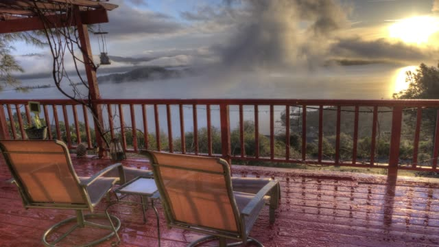 Panoramic Nature Sunrise Landscape View from Large Luxurious Deck with Lounge Chair