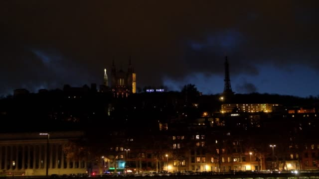 Panoramic night-time view of Lyon, the capital city in France's Auvergne-Rhône-Alpes region, sits at the junction of the Rhône and Saône rivers.