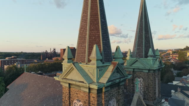 Panoramic scenic view of Bethlehem, Pennsylvania, at sunset. St Joseph's CR Church. Aerial drone video with the ascending camera motion.