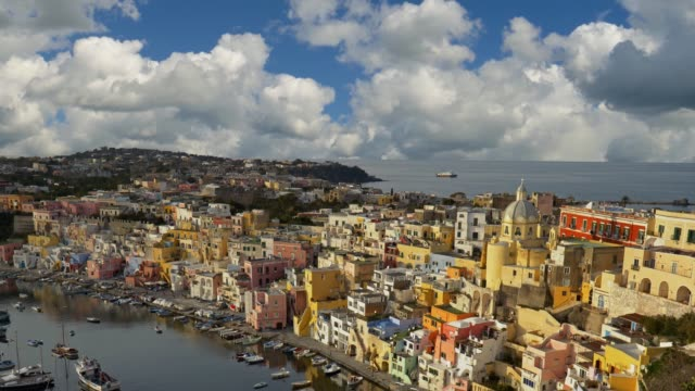 panoramic shot of corriccella village in procida island. colourful small italian fisherman village near naples. italy, naples. 4k - procida video stock e b–roll