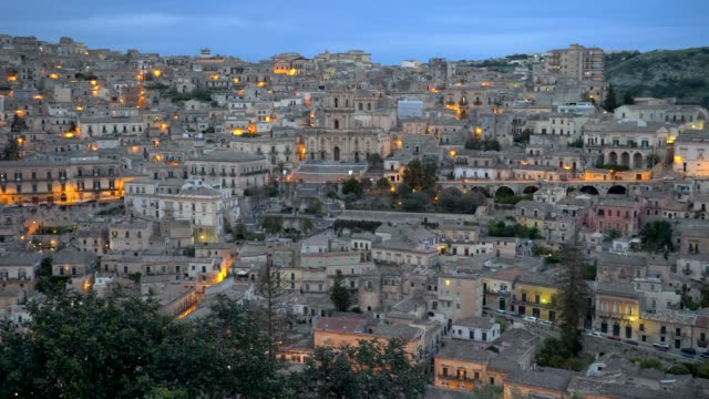 panoramic shot of historical center of modica, unesco world heritage site. sicily, italy - sicily filmów i materiałów b-roll