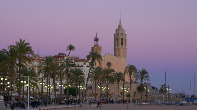 panoramic sunset view on sitges famous church 4k spain video