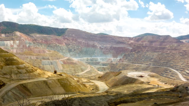 Panoramic time-lapse of trucks and excavators in giant open pit mine Spectacular vista time-lapse of mining trucks in the Chino Santa Rita open cast quarry mine, New Mexico, USA silver metal stock videos & royalty-free footage