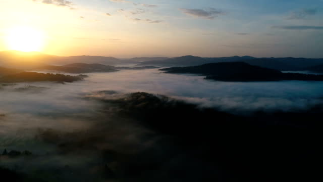 Panoramic video of dreamy foggy valley during sunrise. video