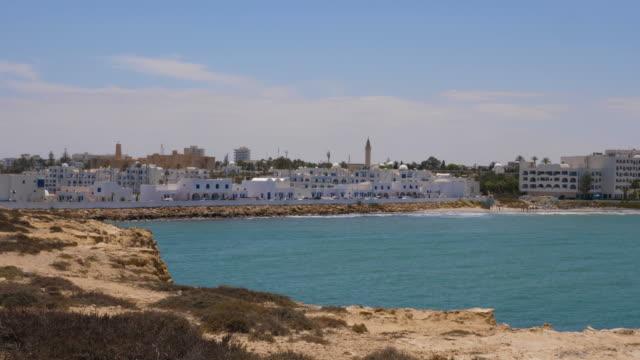 Panoramic view blue sea and Monastir city. Coastline of sea in arabian city.