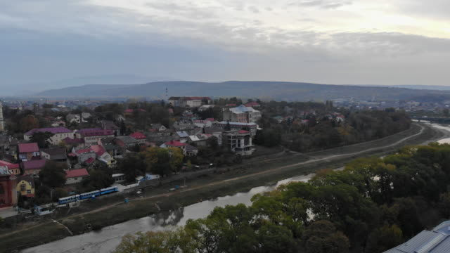 panoramic view flying over of old uzhhorod, ukraine view of river uzh in the city - transcarpazia video stock e b–roll