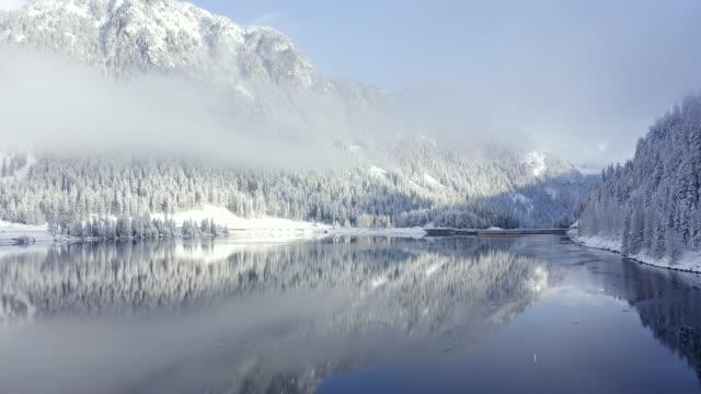 panoramic view of beautiful white winter wonderland scenery in the swiss alps - mountain top filmów i materiałów b-roll