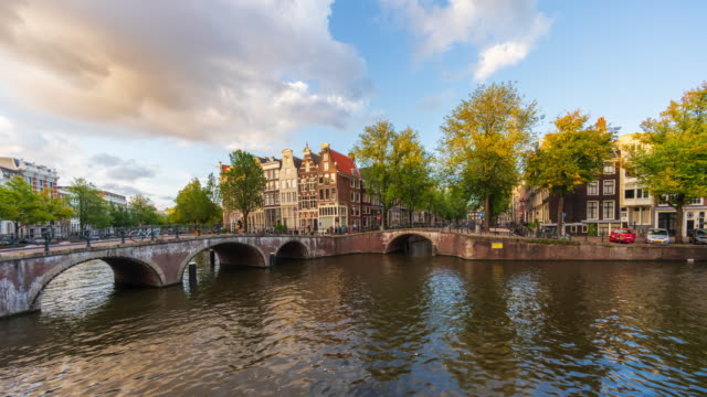 Panoramic view of canal houses with clouds in Amsterdam - 4k time-lapse Canal houses at Leidsegracht and Keizersgracht canal in Amsterdam amsterdam stock videos & royalty-free footage