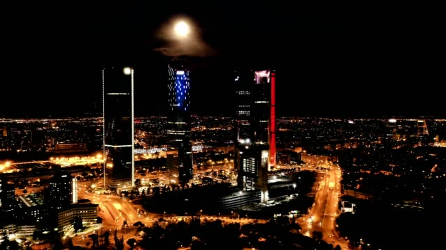 Panoramic view  of illuminated Cuatro Torres Business Area at night Panoramic view from drone of illuminated Cuatro Torres Business Area at night, Madrid, Spain sorpresa stock videos & royalty-free footage