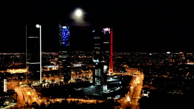 Panoramic view  of illuminated Cuatro Torres Business Area at night, Panoramic view from drone of illuminated Cuatro Torres Business Area at night, Madrid, Spain sorpresa stock videos & royalty-free footage