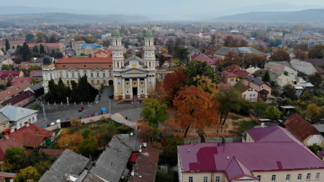 panoramic view of old city from a uzhgorod, ukraine, view of the city and the greek catholic cathedral in the blue sky clouds. - transcarpazia video stock e b–roll