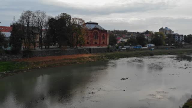 panoramic view of old former uzhgorod synagogue, uzhgorod, ukraine view of river uzh in the city - transcarpazia video stock e b–roll