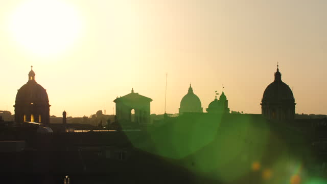 Panoramic view of Rome cityscape from campidoglio terrace at sunset. Seagulls, landmarks, domes of Rome, Italy.