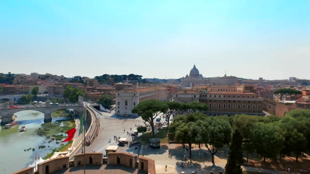 Panoramic view of St. Peter's Basilica and river with bridges from the terrace of Castel St. Angelo