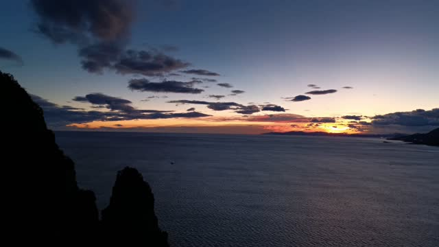 Panoramic view of the bay at sunrise sky with clouds and different colors