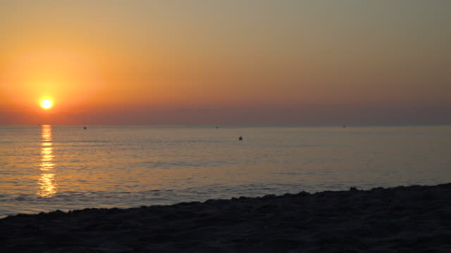 panoramic view of the empty beach and the sea at sunrise - lecce video stock e b–roll