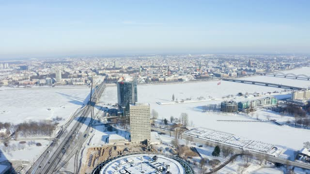 Panoramic view of the Riga city center on a cold winter day. View from above. Flying over frozen river Daugava.