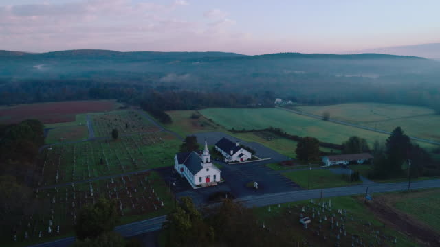 Panoramic view of the small town Brodheadsville in Poconos region, Pennsylvania. Aerial drone video with the panoramic camera motion.