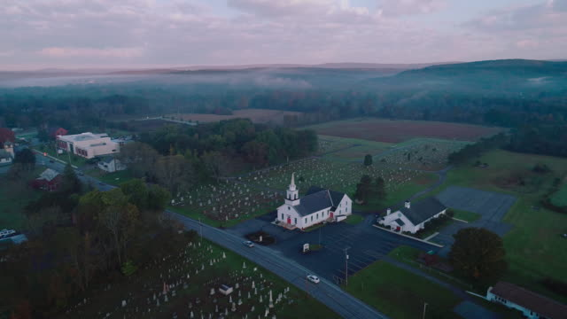 Panoramic view of the small town Brodheadsville in the Appalachian Mountains in Poconos region, Monroe County, Pennsylvania. Aerial drone video with the panoramic camera motion.