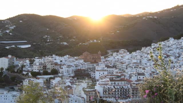 panoramic view of torrox village at sunset - white house filmów i materiałów b-roll
