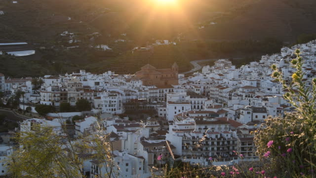 panoramic view of torrox village at sunset with white houses and church - white house filmów i materiałów b-roll