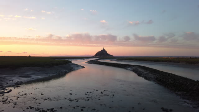 panoramic view of world famous Le Mont Saint-Michel tidal island in beautiful post sunset twilight during blue hour at dusk in summer, Normandy, northern France panoramic view of world famous Le Mont Saint-Michel tidal island in beautiful post sunset twilight during blue hour at dusk in summer, Normandy, northern France neo gothic architecture stock videos & royalty-free footage