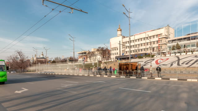 Panoramic view to Sergiyevsky Square and city crossroads with cars traffic and tram stop timelapse, Kharkiv, Ukraine