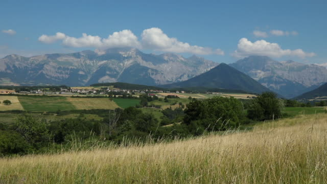 panoriamic of the mountains of the cuchon and petite autane with the village of les faix, champsaur, french alps in summer hautes-alpes - hautes alpes stock videos & royalty-free footage