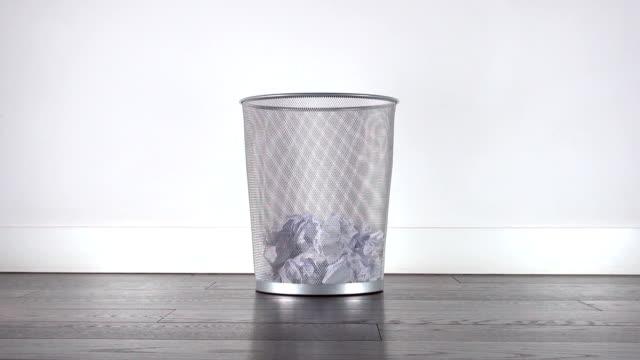 paper balls falling into trash video