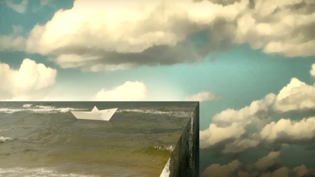 vídeos de stock e filmes b-roll de paper boat on edge of the world. - surrealismo