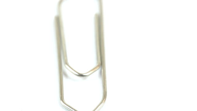 A paper clip on the white table