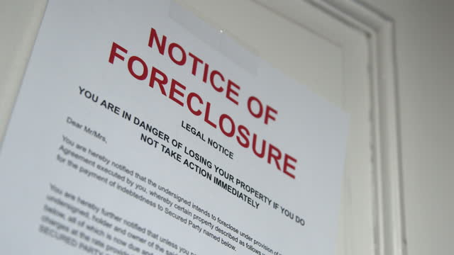 Paper Foreclosure Notice Taped to the Front Door of a Home in a Residential Suburban Neighborhood Paper Forclosure Notice Taped to the Front Door of a Home in a Residential Suburban Neighborhood foreclosure stock videos & royalty-free footage