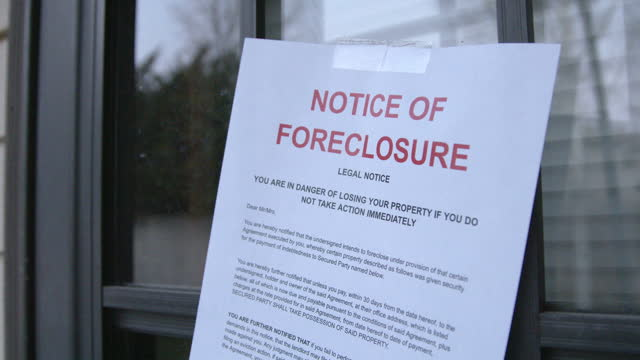 Paper Foreclosure Notice Taped to the Front Storm Door of a Home in a Residential Suburban Neighborhood Paper Forclosure Notice Taped to the Storm Door of a Home in a Residential Suburban Neighborhood foreclosure stock videos & royalty-free footage
