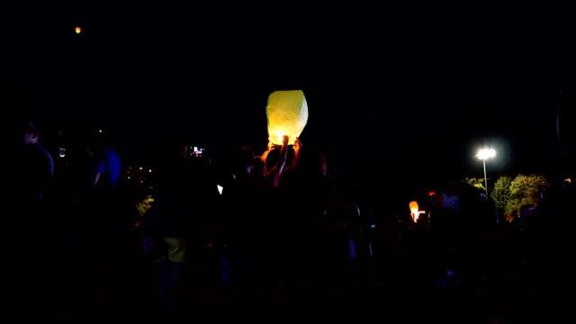 paper lanterns flying up high.
