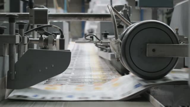 Paper making a corner at a printing factory video